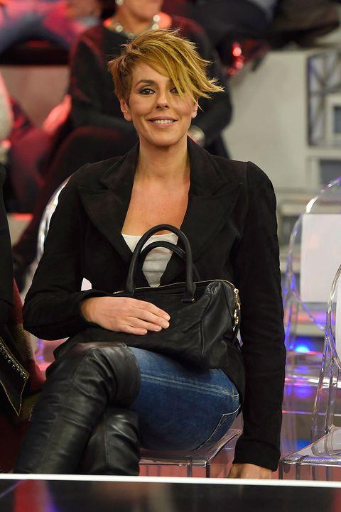 Denim, Jeans, Outerwear, Fashion accessory, Bag, Sitting, Jacket, Leather, Street fashion, Laugh,