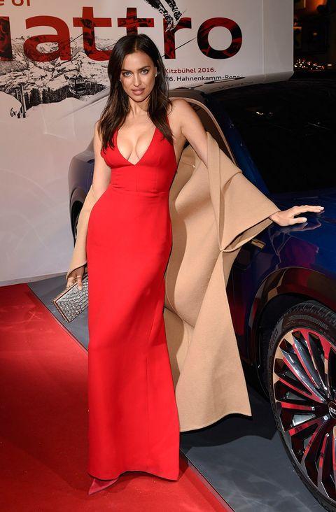 Human, Automotive design, Dress, Red, Alloy wheel, Style, Formal wear, Flooring, Fashion model, Carpet,