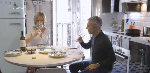 Human body, Table, Glass, Drinkware, Furniture, Sitting, Tableware, Dishware, Countertop, Bottle,