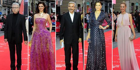 Clothing, Coat, Dress, Trousers, Flooring, Suit, Red, Outerwear, Carpet, Formal wear,