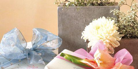 Petal, Paper product, Paper, Cut flowers, Candle, Present, Flowerpot, Peach, Flower Arranging, Floral design,
