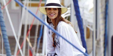 Hat, Sleeve, White, Facial expression, Fashion accessory, Street fashion, Sun hat, Headgear, Costume accessory, Cool,
