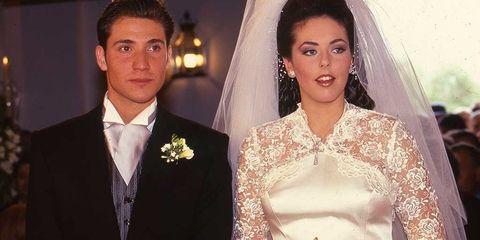 Clothing, Bridal veil, Bridal clothing, Veil, Coat, Forehead, Photograph, Bride, Wedding dress, Outerwear,