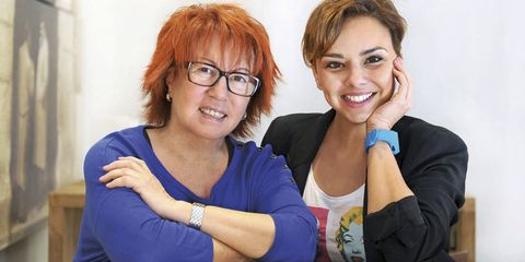 Eyewear, Glasses, Vision care, Smile, Fashion accessory, Interaction, Sitting, Wrist, Red hair, Sharing,