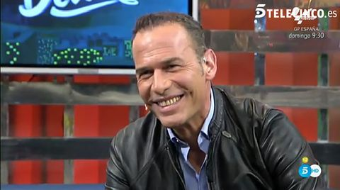 Chin, Forehead, Jacket, Eyebrow, Facial expression, Collar, Logo, Leather, Pleased, Laugh,