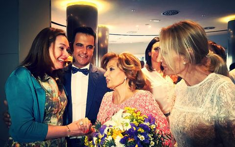 Clothing, Event, Bouquet, Happy, Formal wear, Coat, Jewellery, Suit, Petal, Fashion accessory,