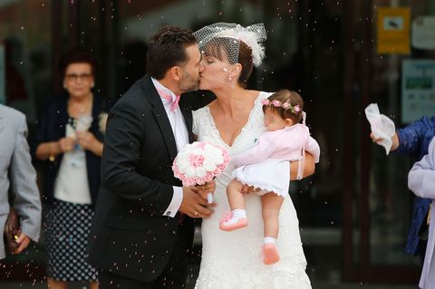 Coat, Trousers, Human body, Event, Outerwear, Happy, Suit, Dress, Kiss, Interaction,