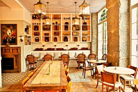 Lighting, Wood, Room, Interior design, Table, Furniture, Amber, Ceiling, Chair, Hardwood,