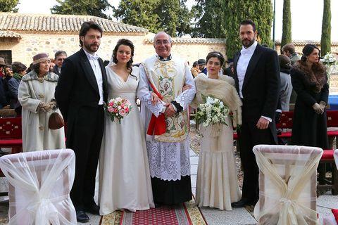 Clothing, Event, Bridal clothing, Petal, Coat, Suit, Photograph, Dress, Bouquet, Formal wear,