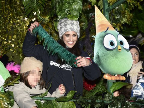 Costume accessory, Costume, Holiday, Costume hat, Fictional character, Mascot, Glove, Plush, Conifer, Lawn ornament,