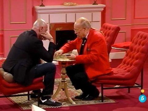 Sitting, Furniture, Comfort, Door, Suit trousers, Conversation, Lap, Carpet, Wood stain, Armrest,