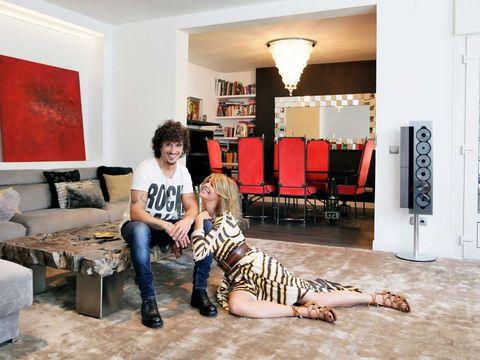 Human, Room, Floor, Interior design, Living room, Flooring, Jeans, Furniture, Home, Interior design,