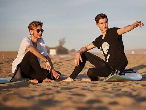 Leg, Sand, Landscape, People in nature, Sitting, Aeolian landform, Sunglasses, People on beach, Desert, Foot,