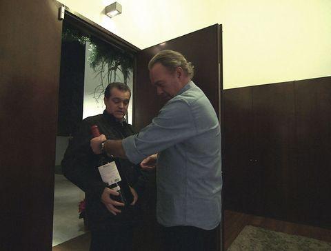 Drink, Bottle, Wine bottle, Glass bottle, Picture frame, Suit trousers, Wine, Distilled beverage, Alcohol,