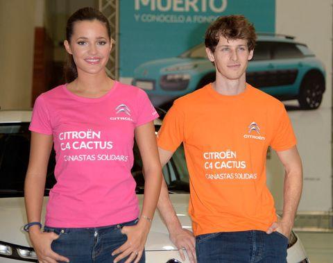Denim, Jeans, T-shirt, Automotive exterior, Vehicle door, Logo, Waist, Trunk, Alloy wheel, Pocket,