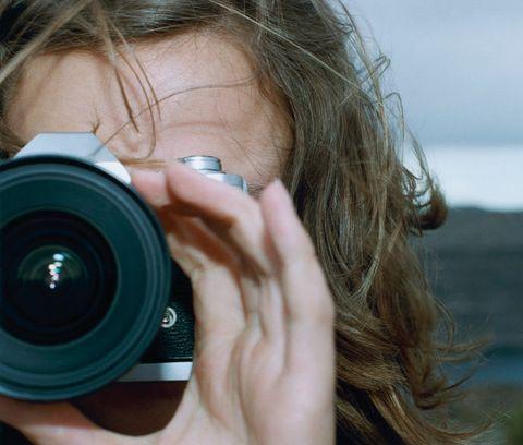 Hair, Finger, Lens, Photographer, Cameras & optics, Camera accessory, Camera lens, Nail, Organ, Digital camera,