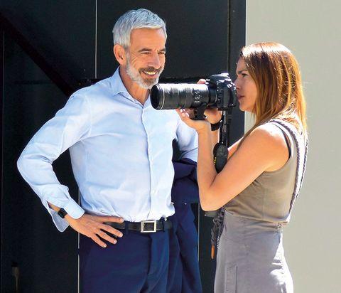 Arm, Dress shirt, Photograph, Lens, Photographer, Camera, Collar, Digital camera, Film camera, Camera accessory,