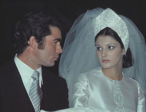 Bridal veil, Veil, Forehead, Bridal accessory, Photograph, Bridal clothing, Coat, Formal wear, Wedding dress, Suit,