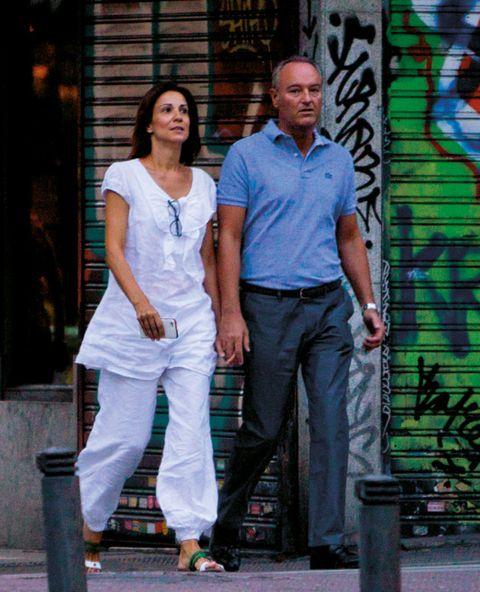 Clothing, Leg, Shirt, Street fashion, Temple, Graffiti, Waist, Pocket, Sandal, Street art,