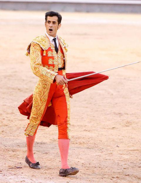 Matador, Shoe, Tradition, Bullring, Sandal, Bullfighting, Costume design, Fashion design,
