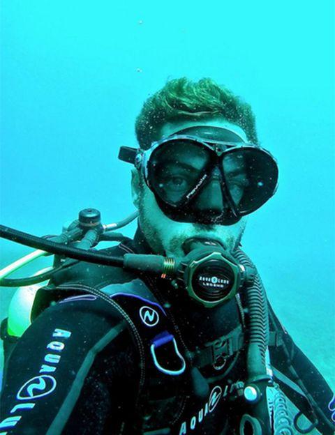 Underwater, Underwater diving, Diving equipment, Personal protective equipment, Fluid, Goggles, Scuba diving, Outdoor recreation, Divemaster, Adventure,