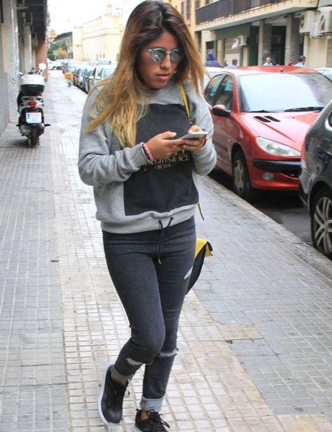 Clothing, Wheel, Tire, Street, Outerwear, Jeans, Road surface, Denim, Street fashion, Alloy wheel,