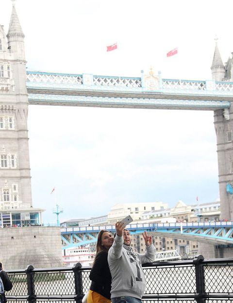 Tourism, Landmark, Travel, Spire, Steeple, Tower, Metropolis, Street fashion, Tourist attraction, Fence,