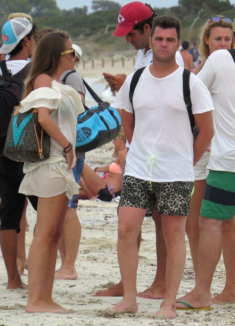 Cap, Leg, Summer, Baseball cap, Hat, Shorts, Barefoot, People in nature, Fashion accessory, Sand,