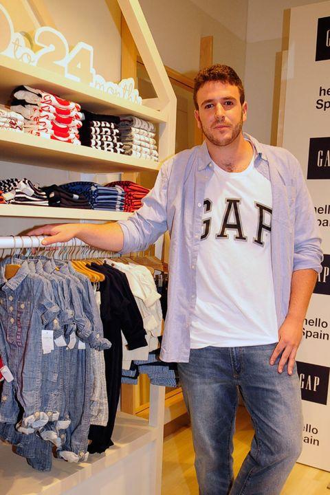 Sleeve, Denim, Jeans, Clothes hanger, Retail, Fashion, Logo, Closet, Outlet store, Pocket,