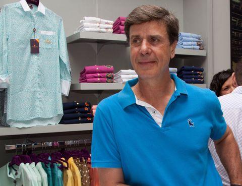 Sleeve, Collar, Clothes hanger, Fashion, Polo shirt, Shelf, Retail, Shelving, Active shirt, Collection,