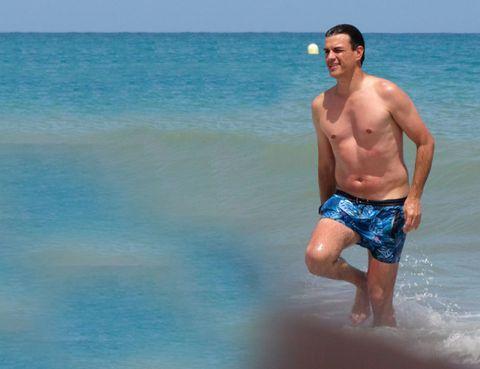 Blue, Fun, Water, Standing, Barechested, Human leg, Leisure, board short, Summer, Aqua,