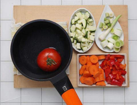 Food, Vegetable, Produce, Ingredient, Cookware and bakeware, Dishware, Orange, Vegan nutrition, Food group, Frying pan,