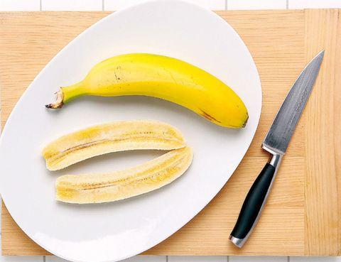 Yellow, Food, Fruit, Banana family, Cooking plantain, Banana, Kitchen knife, Blade, Dishware, Whole food,
