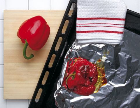 Red, Bell pepper, Kitchen utensil, Hardwood, Kitchen knife, Red bell pepper, Home accessories, Foil, Plastic, Aluminium foil,