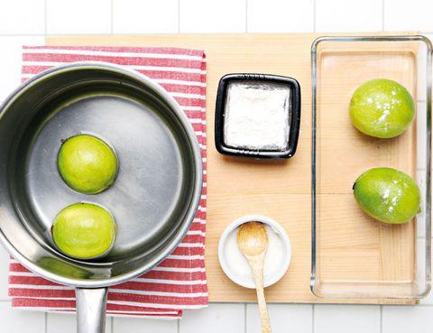 Green, Kitchen utensil, Lemon, Citrus, Dishware, Fruit, Serveware, Chemical compound, Citric acid, Sweet lemon,