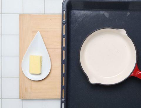 Dishware, Food, Ingredient, Cookware and bakeware, Serveware, Kitchen utensil, Frying pan, Plate, Cutting board, Cheese,