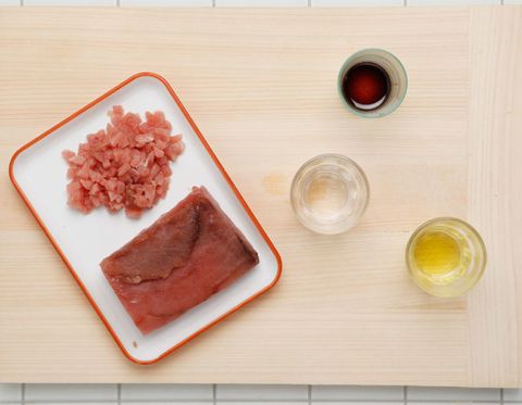 Wood, Pink, Cuisine, Peach, Animal fat, Dish, Ingredient, Animal product, Circle, Meat,