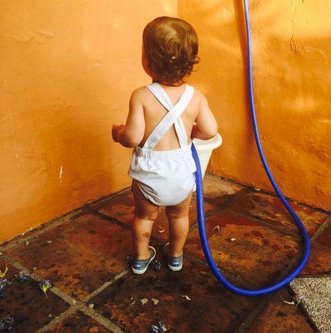 Shoulder, Human leg, Shoe, Floor, Child, Flooring, Elbow, Amber, Baby & toddler clothing, Back,