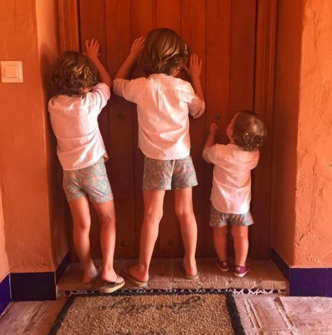 Human leg, Child, Interaction, Shorts, Toddler, Back, Foot, Hip, Baby, Mat,