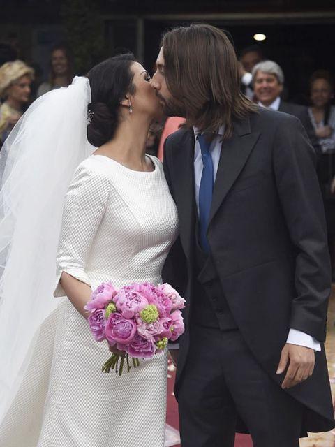 Clothing, Bridal veil, Coat, Forehead, Bridal clothing, Petal, Veil, Photograph, Outerwear, Suit,