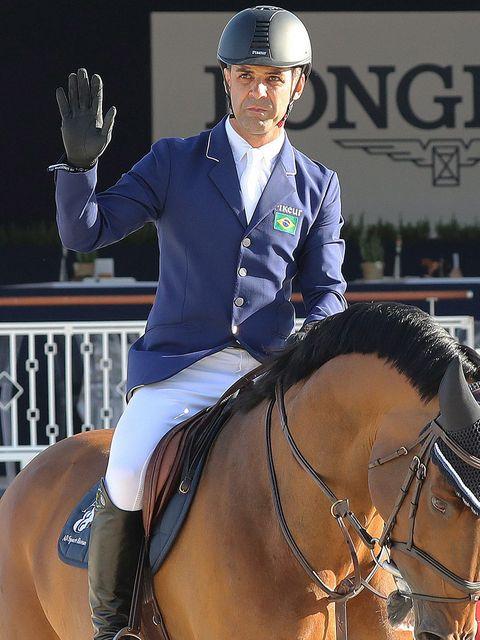 Vertebrate, Horse, Halter, Helmet, Recreation, Horse tack, Shoe, English riding, Saddle, Bridle,
