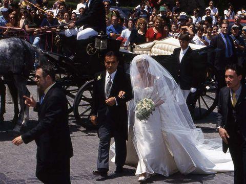 Clothing, People, Coat, Trousers, Bridal veil, Veil, Dress, Suit, Bridal clothing, Photograph,