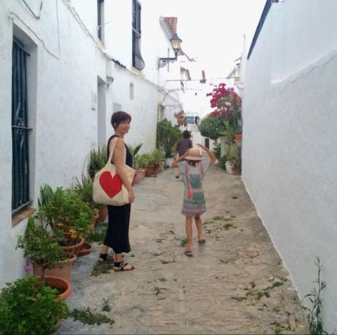 Leg, Window, Neighbourhood, Town, Flowerpot, House, Residential area, Village, Alley, Door,