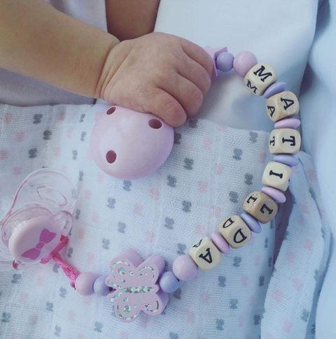 Finger, Pattern, Pink, Nail, Baby & toddler clothing, Wrist, Polka dot, Craft, Creative arts, Circle,