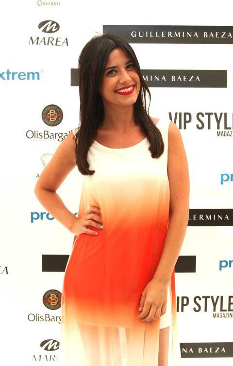 Dress, Hairstyle, Sleeve, Skin, Shoulder, Joint, Eyelash, Facial expression, Style, Orange,