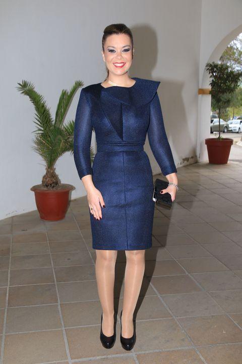 Clothing, Flowerpot, Sleeve, Shoulder, Dress, Human leg, Joint, Waist, One-piece garment, Electric blue,