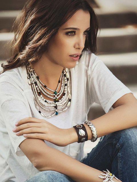 Arm, Hairstyle, Hand, Wrist, Fashion accessory, Style, Jewellery, Sitting, Eyelash, Beauty,