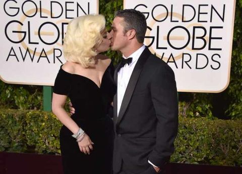 Singer Lady Gaga and actor Taylor Kinney at the 73rd annual Golden Globe Awards on Sunday, Jan. 10, 2016, in Beverly Hills, Calif.