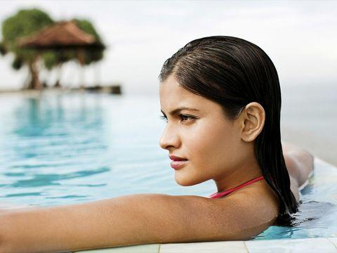 Hairstyle, Water, Liquid, Leisure, Summer, Fluid, Eyelash, Swimming pool, Beauty, Vacation,