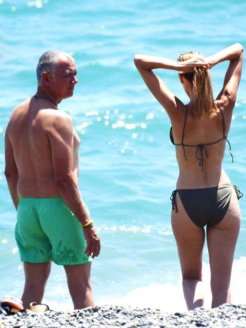 Clothing, Leg, Fun, Human leg, Standing, Brassiere, Elbow, People on beach, Summer, Swimsuit top,